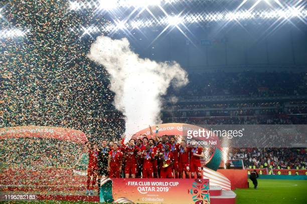 Sadio Mane of Liverpool and teammates celebrate with the FIFA Club World Cup trophy following his team's victory during the FIFA Club World Cup Qatar...