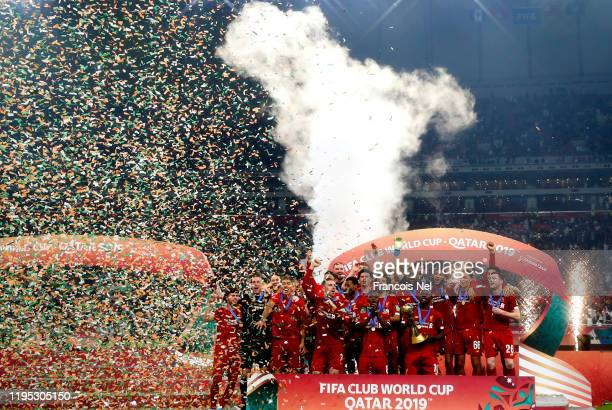 Sadio Mane of Liverpool and teammates celebrate with the FIFA Club World Cup trophy following his team's victory during FIFA Club World Cup Qatar...