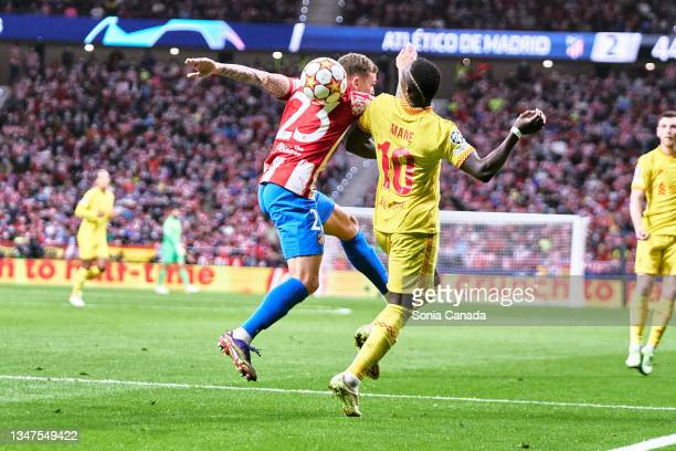 Sadio Mane of Liverpool and Trippier of Atletico de Madrid compete the ball during the UEFA Champions League group B match between Atletico Madrid...