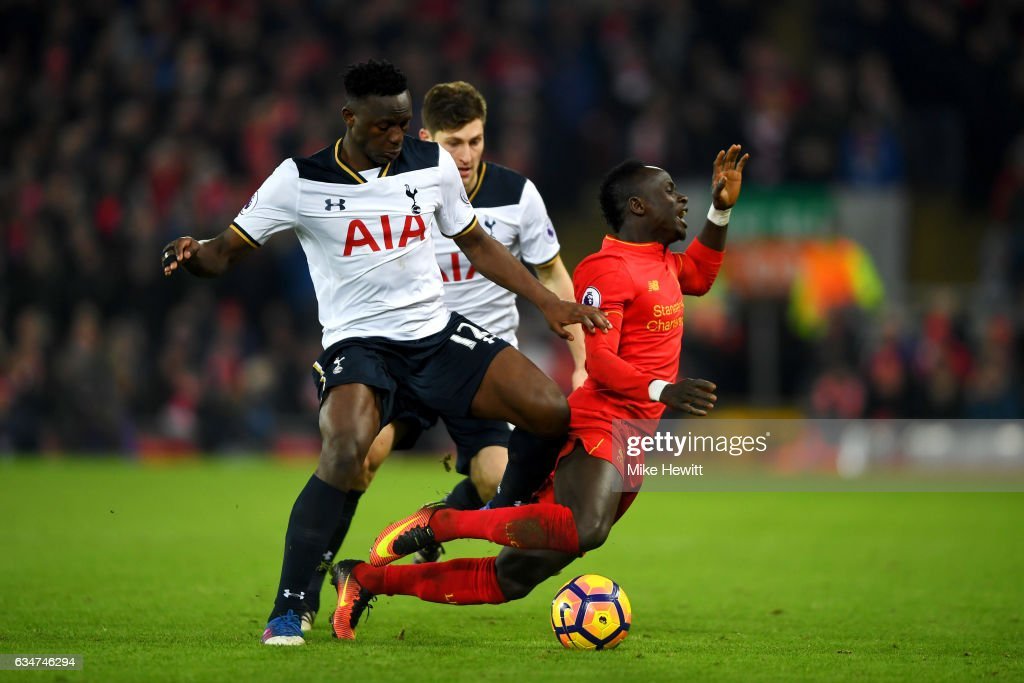 Sadio Mane of Liverpool and Victor Wanyama of Tottenham Hotspur compete for the ball during the Premier League match between Liverpool and Tottenham Hotspur at Anfield on February 11, 2017 in Liverpool, England.