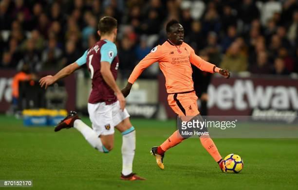 Sadio Mane of Liverpool assist the goal scored by Mohamed Salah of Liverpool during the Premier League match between West Ham United and Liverpool at...
