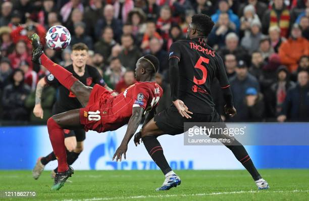 Sadio Mane of Liverpool attempts a overhead kick as he is challenged by Thomas Partey of Atletico Madrid during the UEFA Champions League round of 16...