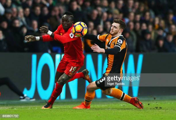 Sadio Mane of Liverpool attempts to take the ball past Andrew Robertson of Hull City during the Premier League match between Hull City and Liverpool...