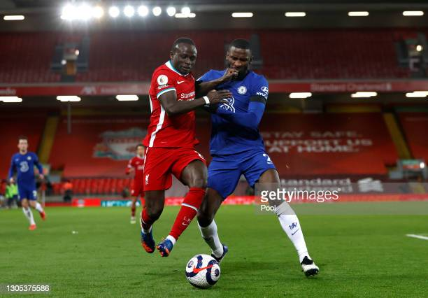 Sadio Mane of Liverpool battles for possession with Antonio Rudiger of Chelsea during the Premier League match between Liverpool and Chelsea at...