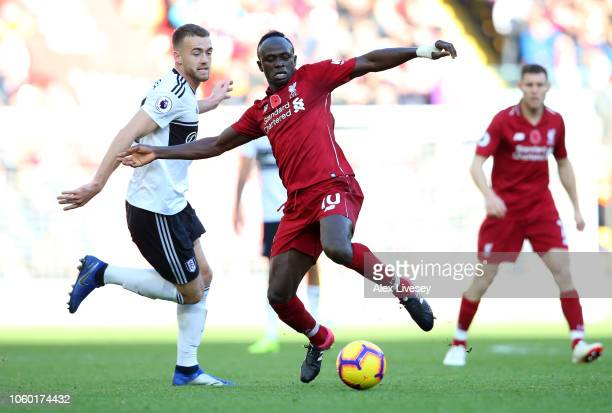 Sadio Mane of Liverpool battles for possession with Calum Chambers of Fulham during the Premier League match between Liverpool FC and Fulham FC at...