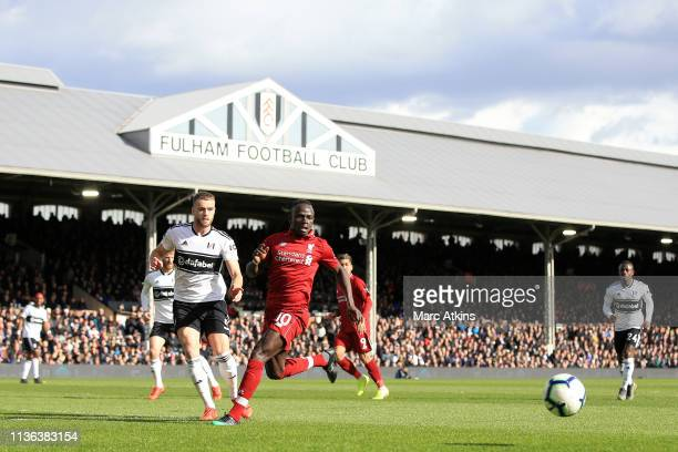 Sadio Mane of Liverpool battles for possession with Calum Chambers of Fulham during the Premier League match between Fulham FC and Liverpool FC at...