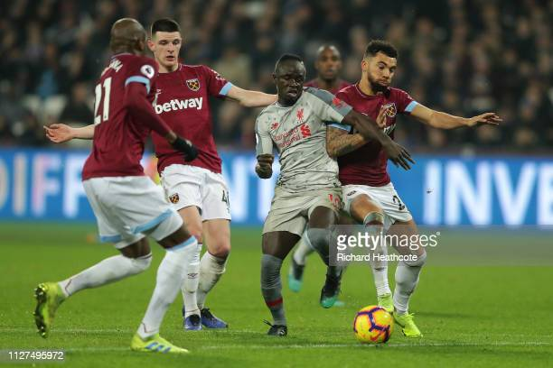 Sadio Mane of Liverpool battles for possession with Declan Rice Angelo Ogbonna and Ryan Fredericks of West Ham United during the Premier League match...