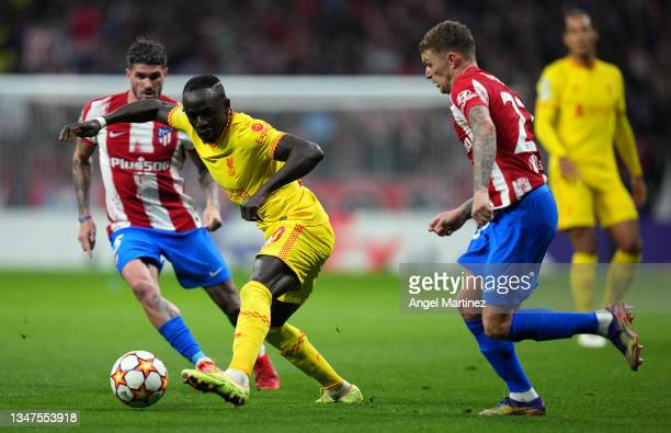 Sadio Mane of Liverpool battles for possession with Kieran Trippier of Atletico Madrid during the UEFA Champions League group B match between...
