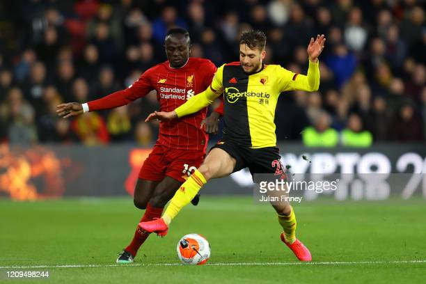 Sadio Mane of Liverpool battles for possession with Kiko Femenia of Watford during the Premier League match between Watford FC and Liverpool FC at...
