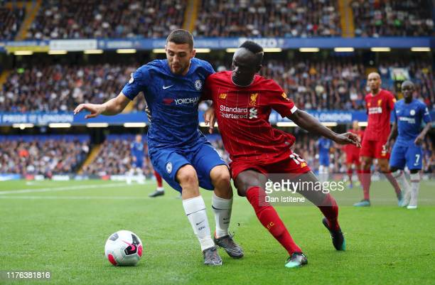 Sadio Mane of Liverpool battles for possession with Mateo Kovacic of Chelsea during the Premier League match between Chelsea FC and Liverpool FC at...