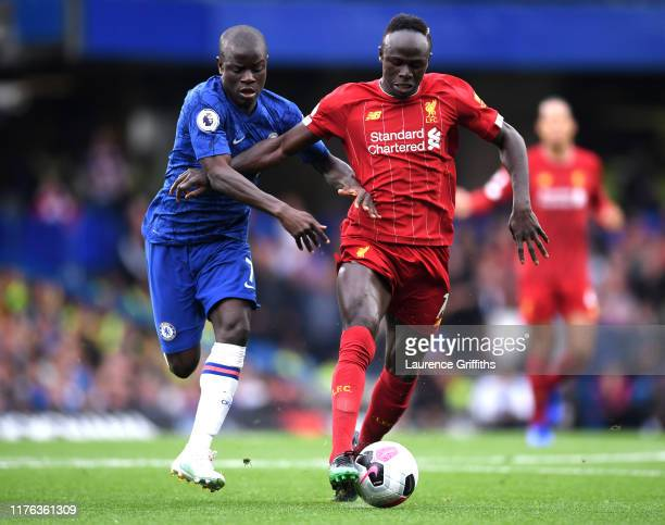 Sadio Mane of Liverpool battles for possession with N'Golo Kante of Chelsea during the Premier League match between Chelsea FC and Liverpool FC at...
