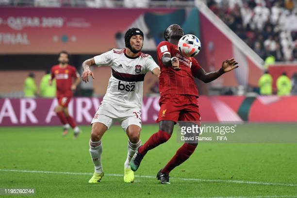 Sadio Mane of Liverpool battles for possession with Rafinha of CR Flamengo during the FIFA Club World Cup Qatar 2019 Final match between Liverpool FC...