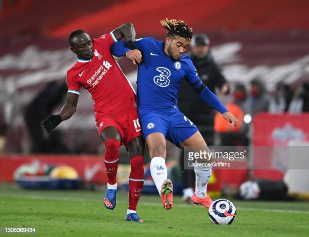 Sadio Mane of Liverpool battles for possession with Reece James of Chelsea during the Premier League match between Liverpool and Chelsea at Anfield...