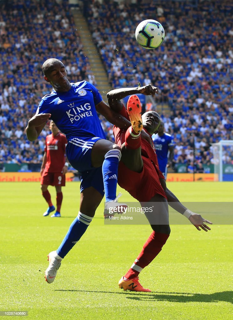 Sadio Mane of Liverpool battles for possession with Ricardo Pereira of Leicester City during the Premier League match between Leicester City and Liverpool FC at The King Power Stadium on September 1, 2018 in Leicester, United Kingdom.