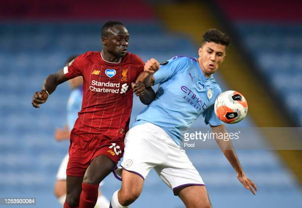 Sadio Mane of Liverpool battles for possession with Rodrigo of Manchester City during the Premier League match between Manchester City and Liverpool...