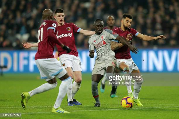 Sadio Mane of Liverpool battles for possession with Ryan Fredericks of West Ham United during the Premier League match between West Ham United and...