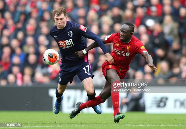 Sadio Mane of Liverpool battles for the ball with Jack Stacey of AFC Bournemouth during the Premier League match between Liverpool FC and AFC...