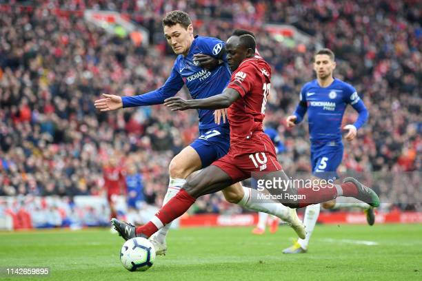 Sadio Mane of Liverpool battles with Andreas Christiansen of Chelsea during the Premier League match between Liverpool FC and Chelsea FC at Anfield...