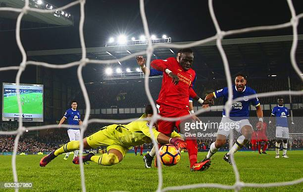 Sadio Mane of Liverpool beats Joel Robles of Everton as he scores their first goal during the Premier League match between Everton and Liverpool at...