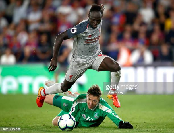 Sadio Mane of Liverpool breaks past Wayne Hennessey of Crystal Palace leading on to score his side's second goal during the Premier League match...