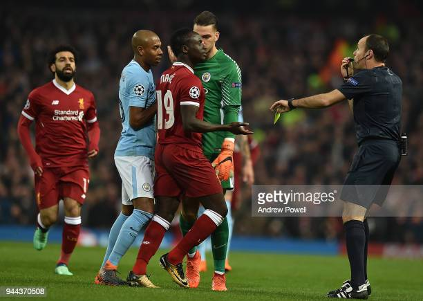 Sadio Mane of Liverpool brings down Nicolas Otamendi of Mancity and gets booked during the UEFA Champions League Quarter Final Second Leg match...