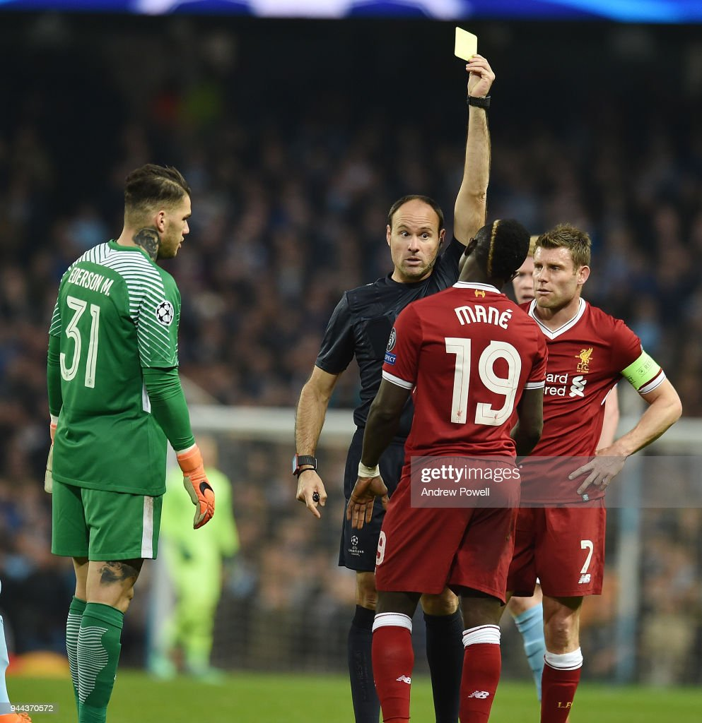 Sadio Mane of Liverpool brings down Nicolas Otamendi of Mancity and gets booked during the UEFA Champions League Quarter Final Second Leg match between Manchester City and Liverpool at Etihad Stadium on April 10, 2018 in Manchester, England.