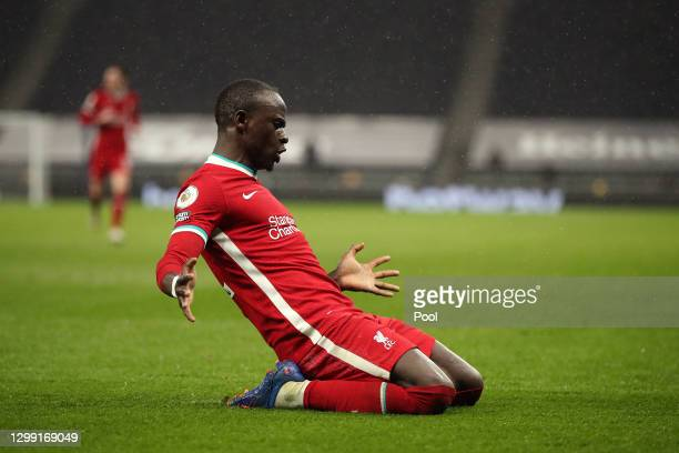Sadio Mane of Liverpool celebrates after he scores his sides 3rd goal during the Premier League match between Tottenham Hotspur and Liverpool at...