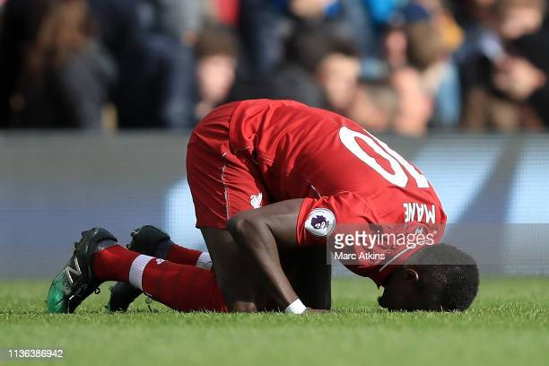 Sadio Mane of Liverpool celebrates after he scores his sides first goal during the Premier League match between Fulham FC and Liverpool FC at Craven...
