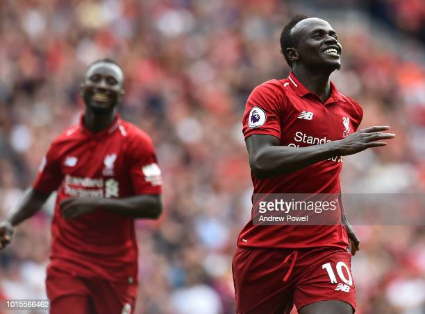 Sadio Mane of Liverpool celebrates after scoring a goal during the Premier League match between Liverpool FC and West Ham United at Anfield on August...