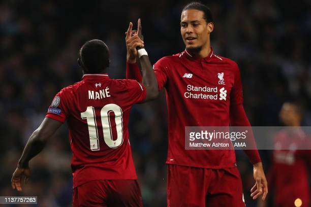 Sadio Mane of Liverpool celebrates after scoring a goal to make it 0-1 with Virgil van Dijk of Liverpool during the UEFA Champions League Quarter...