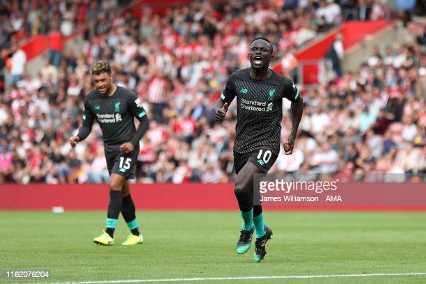 Sadio Mane of Liverpool celebrates after scoring a goal to make it 01 during the Premier League match between Southampton FC and Liverpool FC at St...