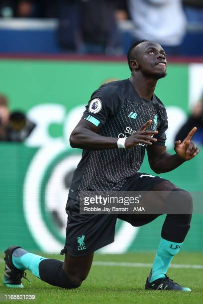 Sadio Mane of Liverpool celebrates after scoring a goal to make it 01 during the Premier League match between Burnley FC and Liverpool FC at Turf...