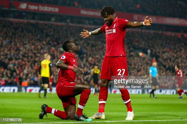 Sadio Mane of Liverpool celebrates after scoring a goal to make it 1-0 during the Premier League match between Liverpool FC and Watford FC at Anfield...