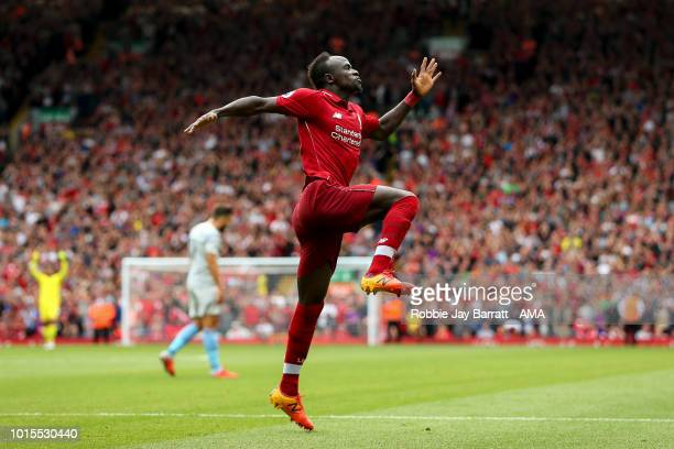 Sadio Mane of Liverpool celebrates after scoring a goal to make it 30 during the Premier League match between Liverpool FC and West Ham United at...