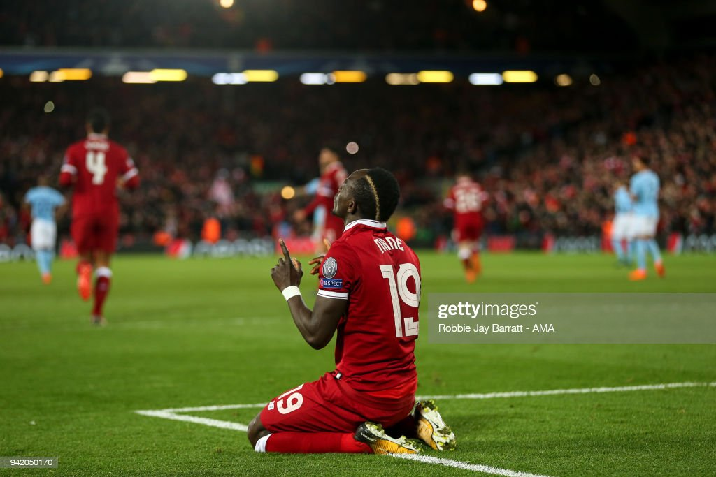 Sadio Mane of Liverpool celebrates after scoring a goal to make it 3-0 during the UEFA Champions League Quarter Final first leg match between Liverpool and Manchester City at Anfield on April 4, 2018 in Liverpool, England.