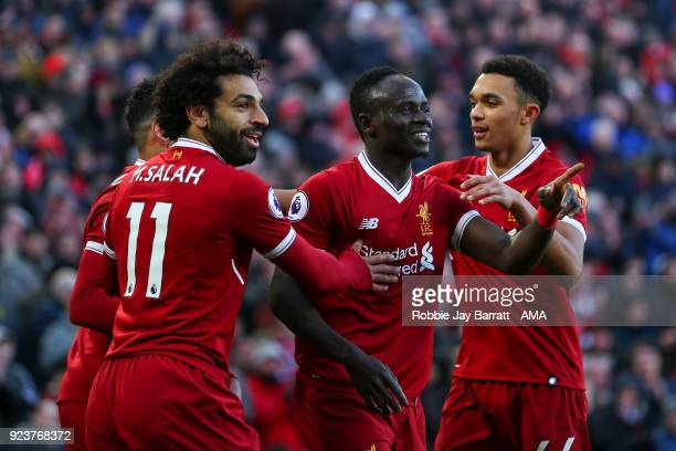 Sadio Mane of Liverpool celebrates after scoring a goal to make it 41 during the Premier League match between Liverpool and West Ham United at...