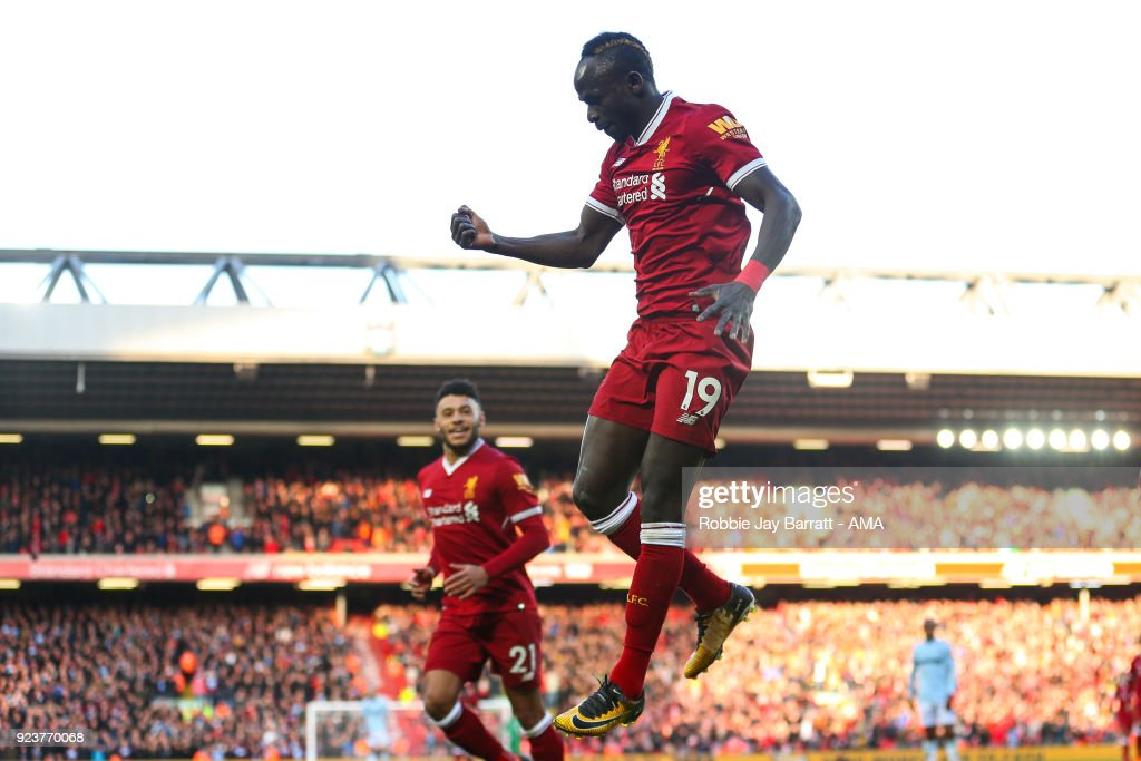 Sadio Mane of Liverpool celebrates after scoring a goal to make it 4-1 during the Premier League match between Liverpool and West Ham United at Anfield on February 24, 2018 in Liverpool, England.