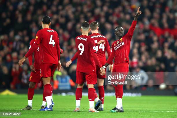 Sadio Mane of Liverpool celebrates after scoring his sides first goal during the Premier League match between Liverpool FC and Wolverhampton...