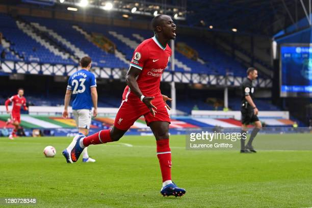 Sadio Mane of Liverpool celebrates after scoring his sides first goal during the Premier League match between Everton and Liverpool at Goodison Park...
