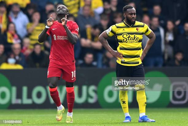 Sadio Mane of Liverpool celebrates after scoring his sides first goal as Danny Rose of Watford looks on during the Premier League match between...