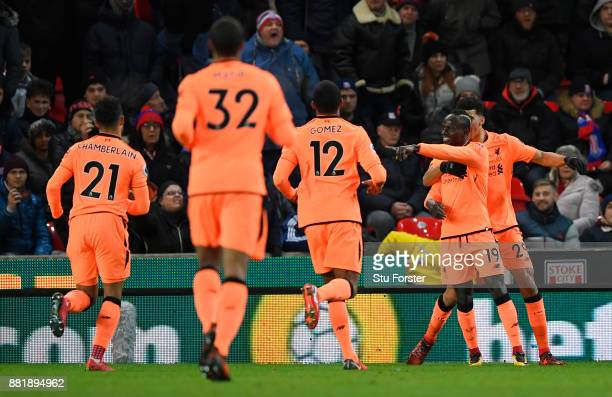 Sadio Mane of Liverpool celebrates after scoring his sides first goal with his Liverpool team mates during the Premier League match between Stoke...