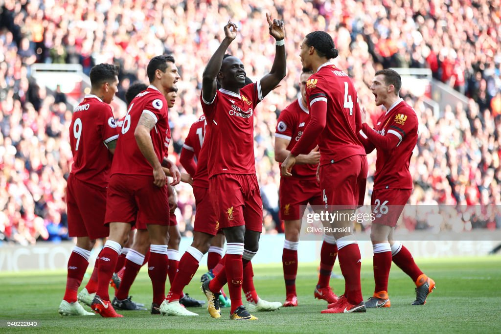 Sadio Mane of Liverpool celebrates after scoring his sides first goal with his Liverpool team mates during the Premier League match between Liverpool and AFC Bournemouth at Anfield on April 14, 2018 in Liverpool, England.