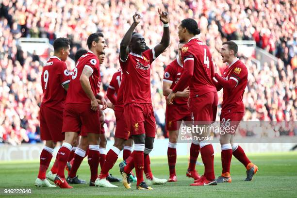 Sadio Mane of Liverpool celebrates after scoring his sides first goal with his Liverpool team mates during the Premier League match between Liverpool...