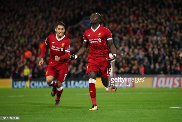 Sadio Mane of Liverpool celebrates after scoring his sides fourth goal with Roberto Firmino of Liverpool during the UEFA Champions League group E...