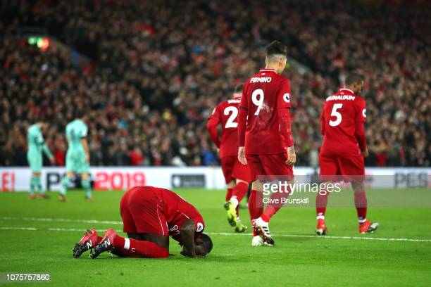 Sadio Mane of Liverpool celebrates after scoring his sides second goal during the Premier League match between Liverpool FC and Arsenal FC at Anfield...