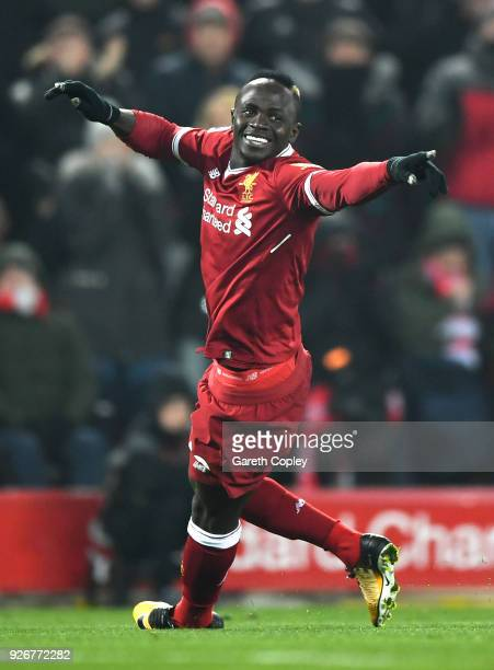 LIVERPOOL ENGLAND MARCH 03 Sadio Mane of Liverpool celebrates after scoring his sides second goal during the Premier League match between Liverpool...