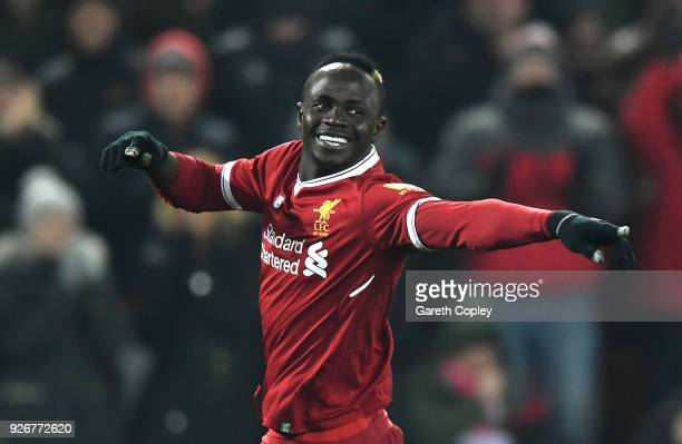 Sadio Mane of Liverpool celebrates after scoring his sides second goal during the Premier League match between Liverpool and Newcastle United at...