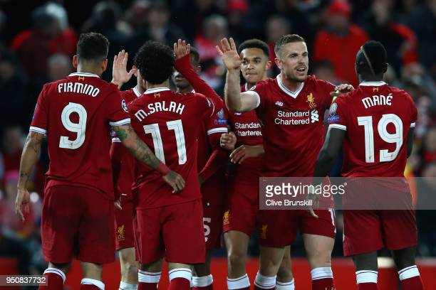 Sadio Mane of Liverpool celebrates after scoring his sides third goal with team mates during the UEFA Champions League Semi Final First Leg match...