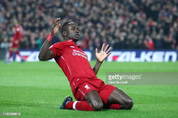 Sadio Mane of Liverpool celebrates after scoring his team's first goal during the Premier League match between Liverpool FC and Watford FC at Anfield...