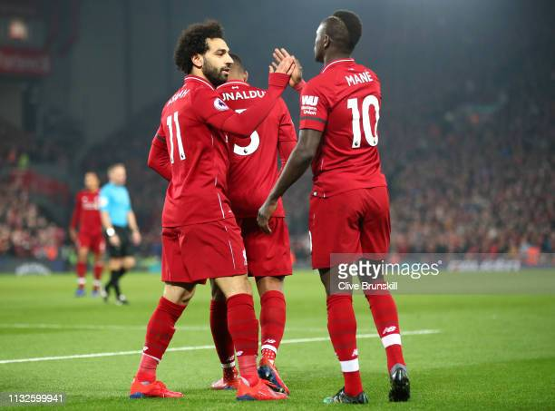 Sadio Mane of Liverpool celebrates after scoring his team's first goal with Mohamed Salah of Liverpool during the Premier League match between...